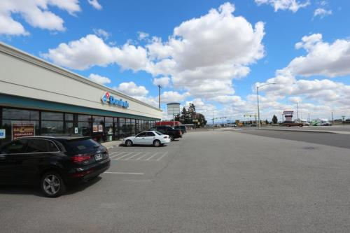 Newer 7,800 sqft strip mall located between Walmart and FAFB. 1,200 sqft is already leased to Dominos at $20.15/ft NNN. 6,600 sqft vacant and ready for  lease or owner/occupant. Located on corner of Campbell & Sunset Hwy. 15 customer parking spaces in front plus comes with15,000 sqft lot behind paved  for another 17 car parks. 12' ceilings.  Owner terms available